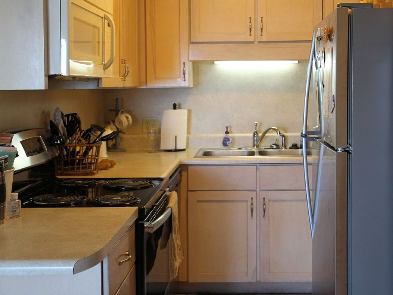Simple snacks and home cooked meals are easy in the well appointed kitchen.