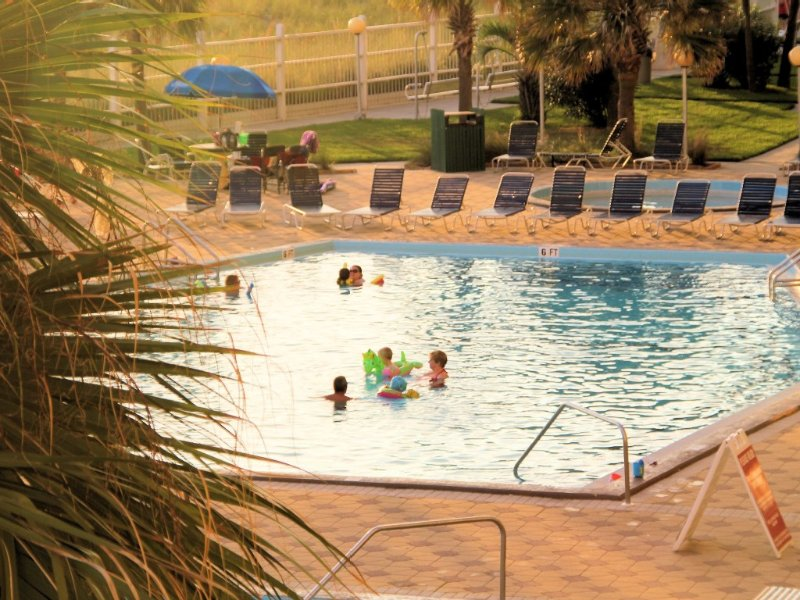 Large pool is heated in cool weather.