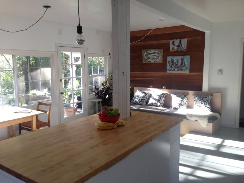 Open, light-filled kitchen, sitting, and dining area.