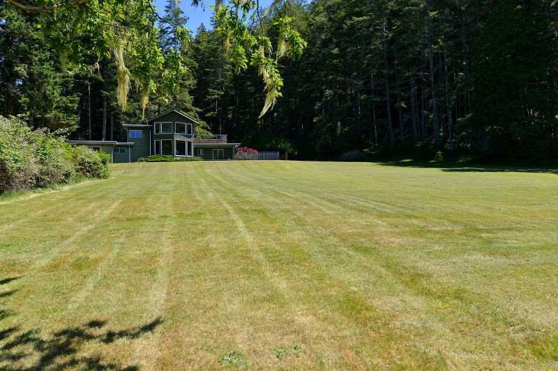 Expansive lawn cascades down to the ocean