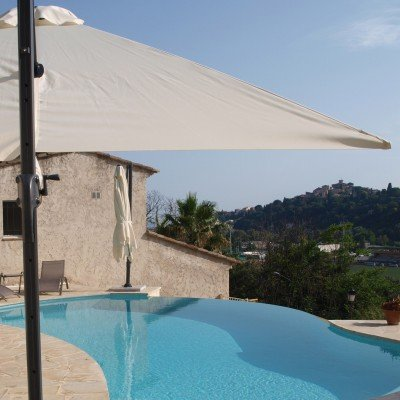 The infinity pool of the villa with open views of the sea Cagnes medieval village