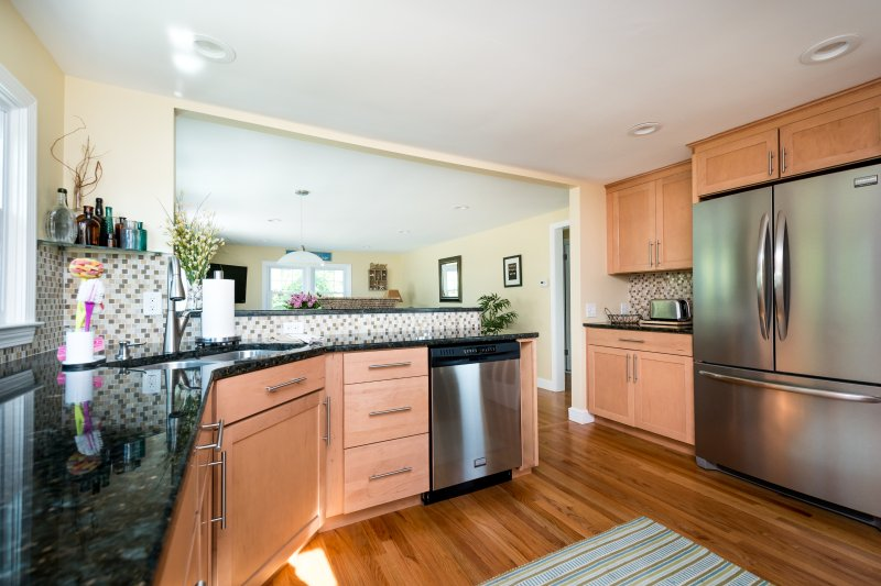 all stainless steel working kitchen that opens to family room