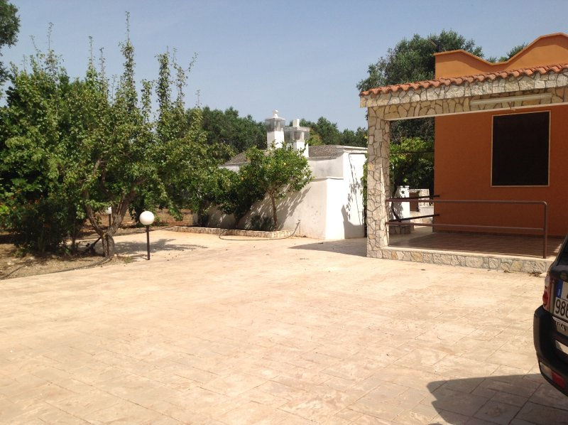Outside courtyard. Ample space for parking & alfresco dining.