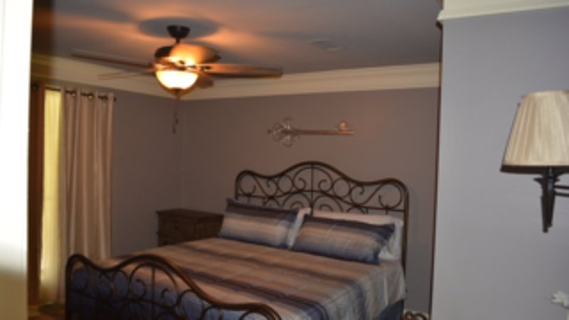 Third bedroom with King size bed, TV, and lighted work desk