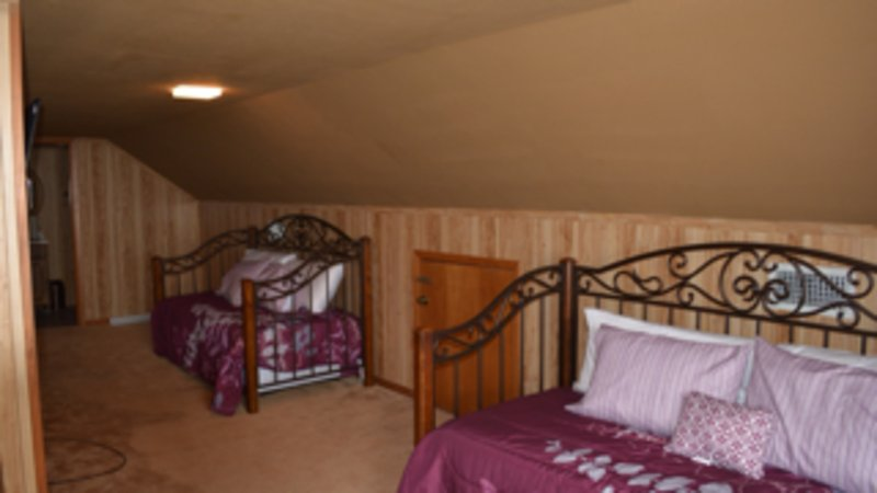 Fifth bedroom loft with double twin day beds with trundle