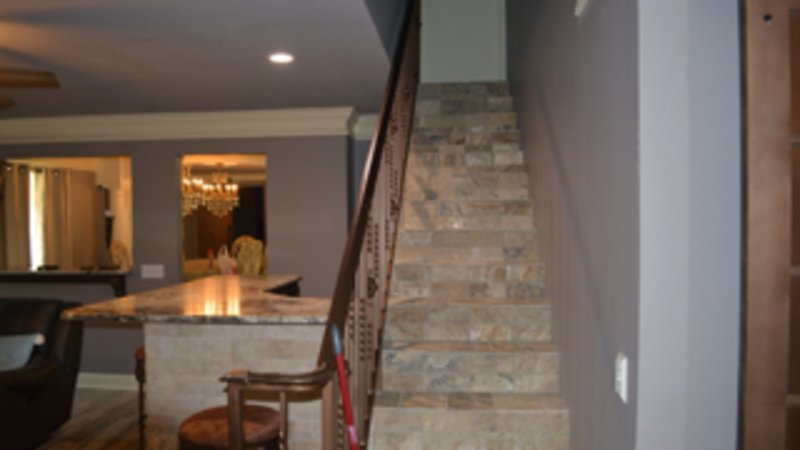 Stairway to second floor gameroom and loft with twin daybeds with trundle