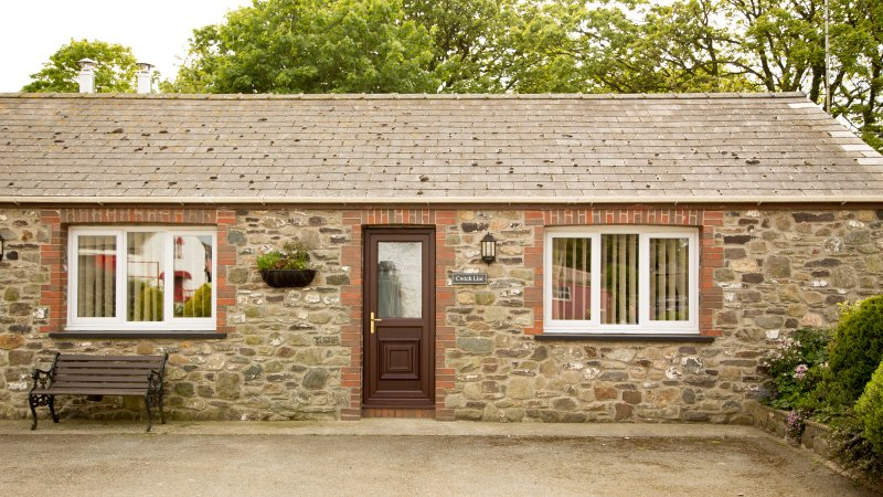 Front view of Cwtch Lloi Cottage in the Courtyard.