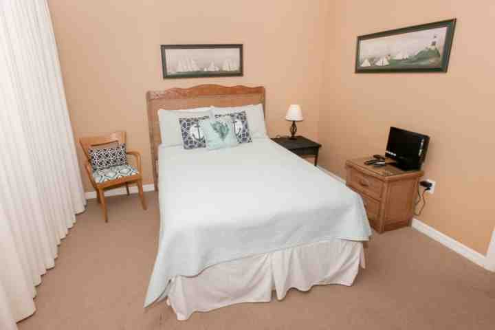 Guest room with double bed and flat screen TV