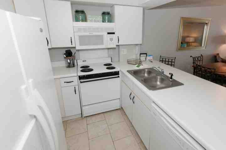 Efficient kitchen with full sized appliances and plenty of cabinets
