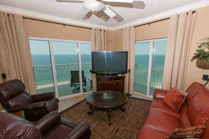 Living room with sliding glass doors overlooking Gulf-front balcony