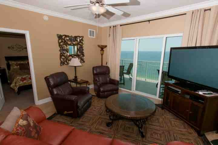 Living room with 54' Plasma flat screen TV, PS3, BluRay player and Bose surround sound