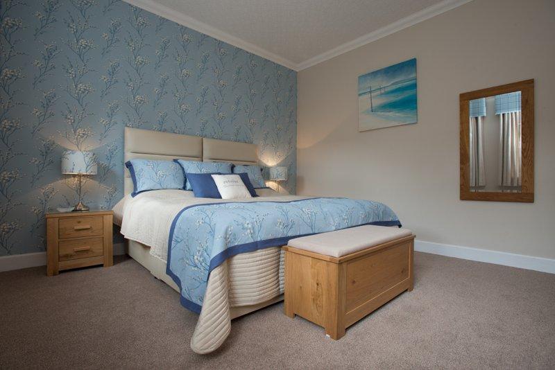 Cada quarto pode ser configurado para uma cama king size ou duas camas individuais.