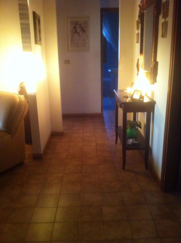 The apartment is bright and spacious complete with closets and dressers tablecloths tableware