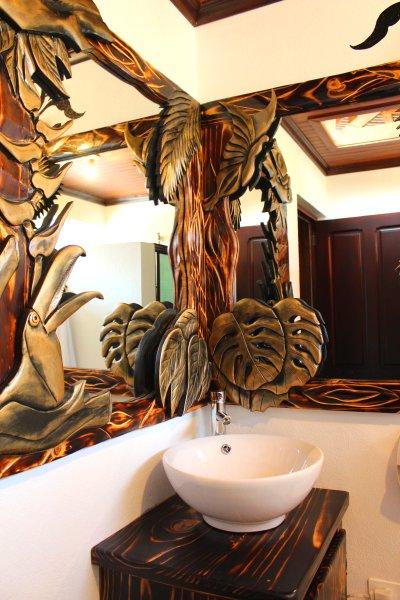 Second bathroom with unique mirror.