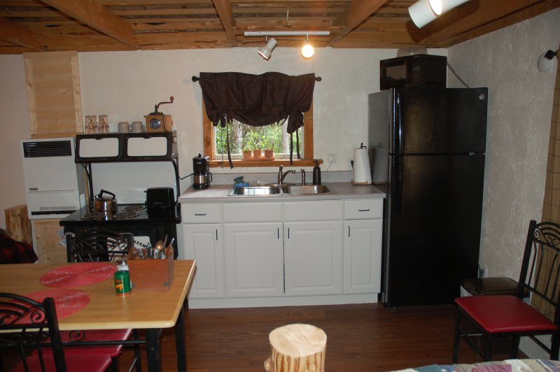 Kitchenette with full refrigerator and icemaker, stovetop (no oven), microwave, coffee pot and toast