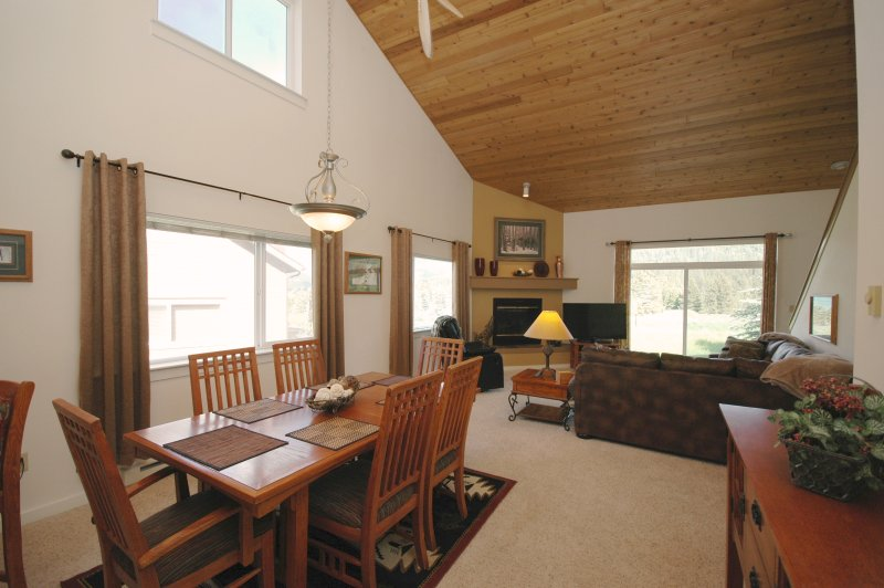 Open floor plan.   Looking across the room towards the living room from the entrance into the home.