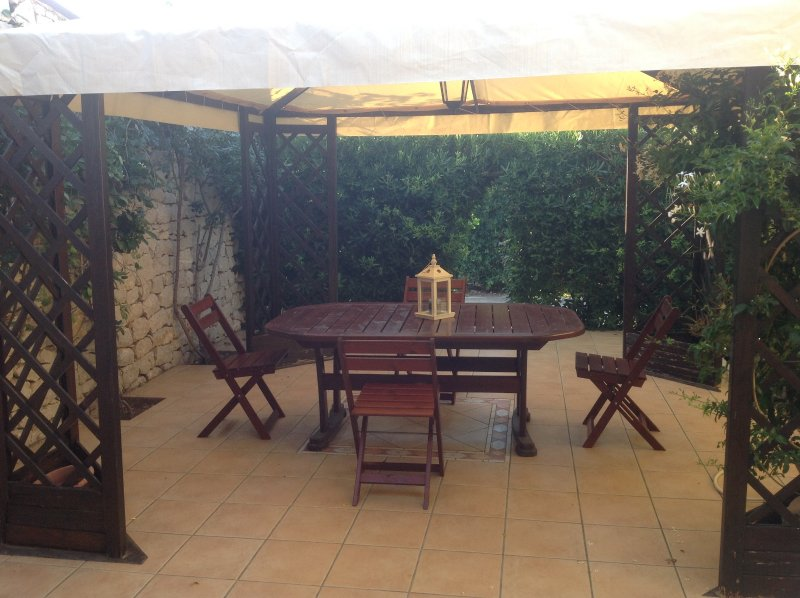 GAZEBO WITH WOODEN TABLE AND CHAIRS