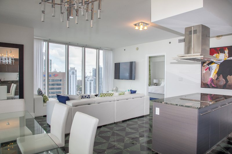 Dining area, kitchen and living, in a large condo