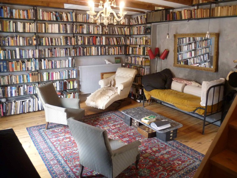 Living room /Library just off the door to the outdoor pool
