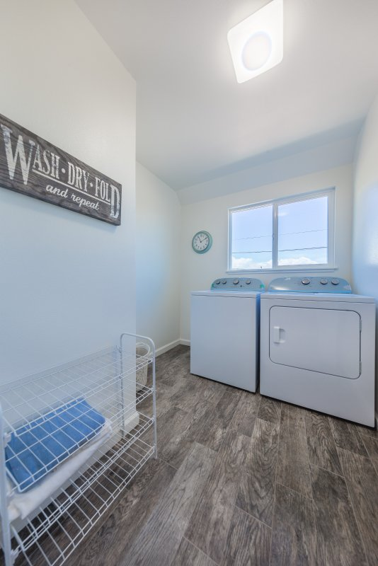 Laundry room at end of hall