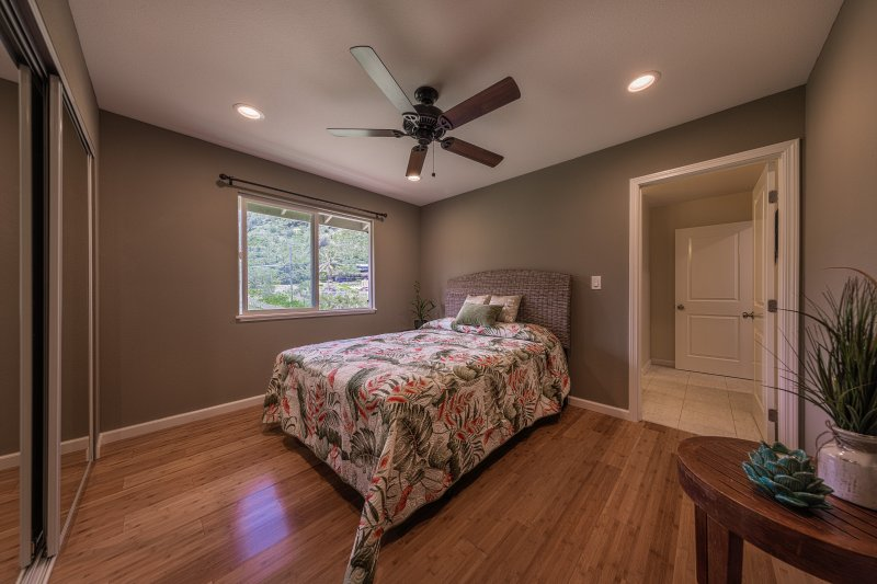 Upstairs bedroom with queen bed and shared bath