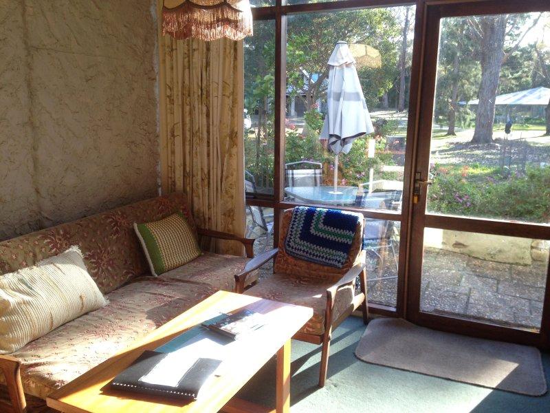 Downstairs lounge overlooking alfresco patio and garden