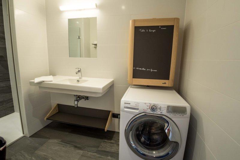 Bathroom room 2, Changing Table and washing machine