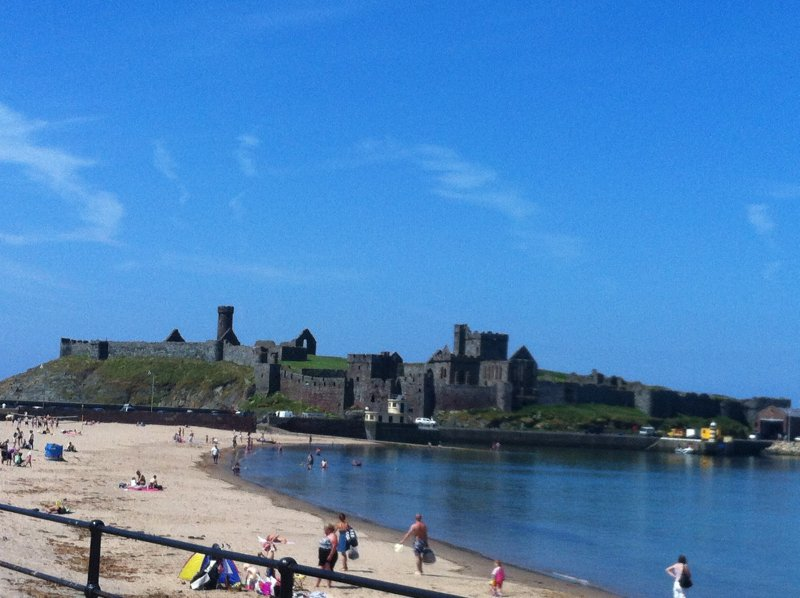 Our lovely sandy beach and our historic Peel castle.  The sunset in Peel are amazing, come see