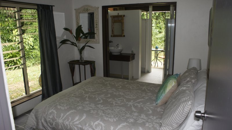 The Rainforest room - with tropical shower room and private deck overlooking garden.