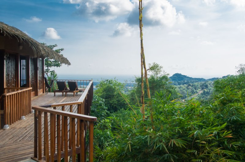 Wrap-around teak decking offering impressive sea, mountain and jungle canopy views