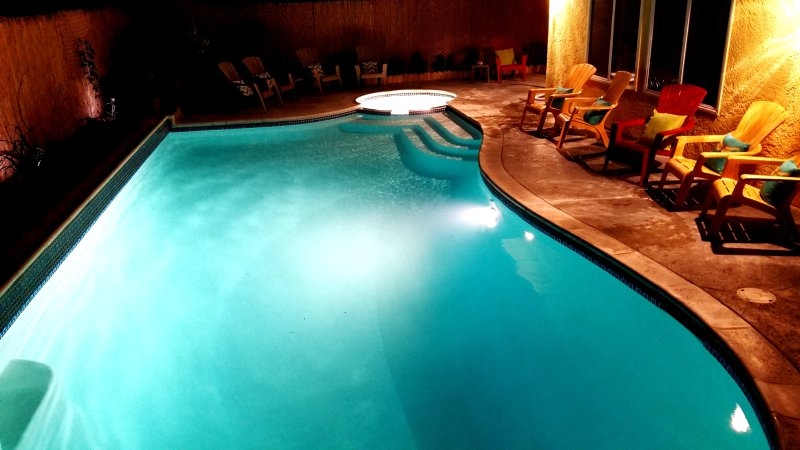 Take a relaxing swim at night in this exotic pool & spa.