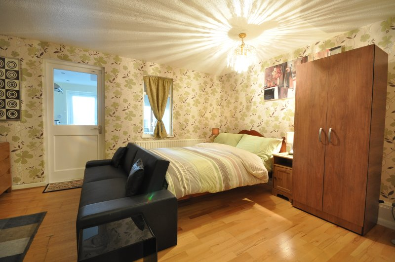 Guest will walk into a room with nicely made bed with clean linens