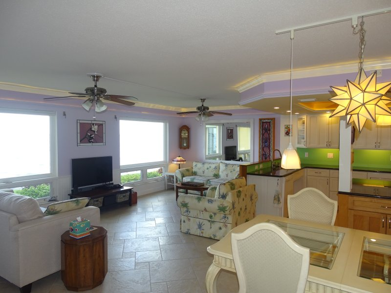 Enjoy the panoramic views of Charlotte Harbor from this spacious great room.