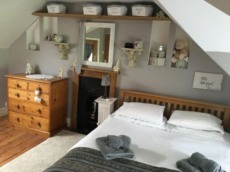Attic Bedroom with en-suite Toilet sink, also has wi-fi and  TV