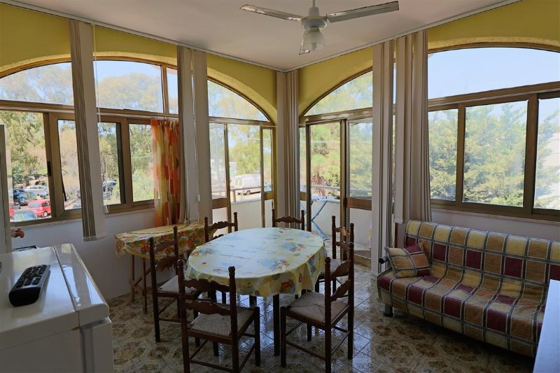 Holiday house on the first floor in villa in Gallipoli Padula Bianca beach front, alquiler vacacional en Lido Conchiglie