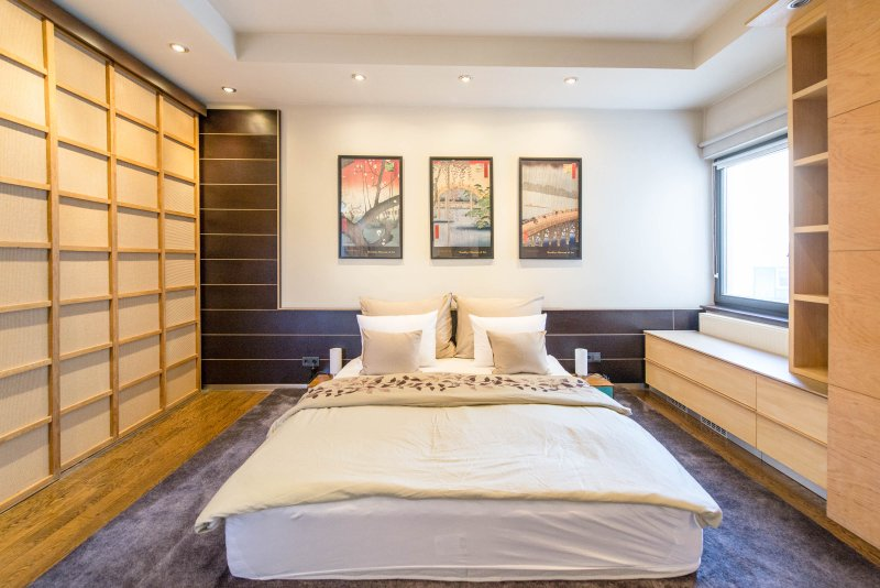 Asian-design inspired bedroom with king sized mattress and luxurious Marriot mattress topper