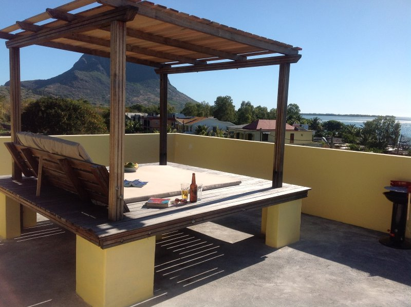 Panoramic sea views to Le Morne from our giant sunbeds