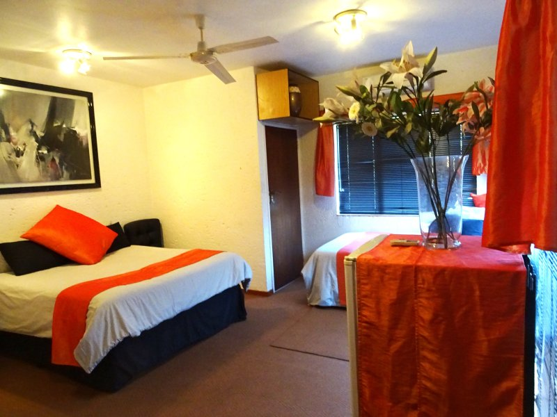 Spacious room on bottom level, Queen &¾ beds, own entrance, toilet & basin, cupboards, fan, fridge