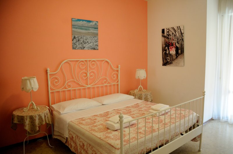 Bedroom with double bed, 32 inch TV and balcony access