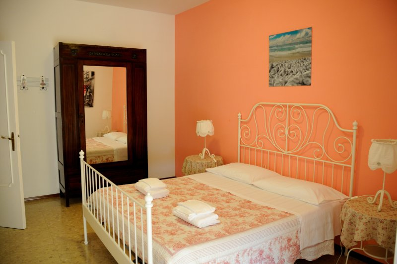 Bedroom with double bed, TV and balcony access