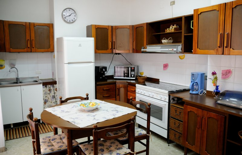 Kitchen with refrigerator, freezer, oven, microwave, coffee maker.