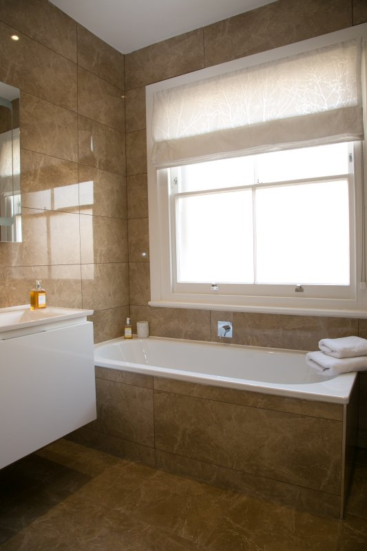The Arlington Suite beautifully appointed bathroom with slipper bath and walk in shower.
