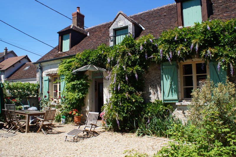 Maison Doiseau in summer;  we have outside dining and loungers, BBQ and a large orchard garden