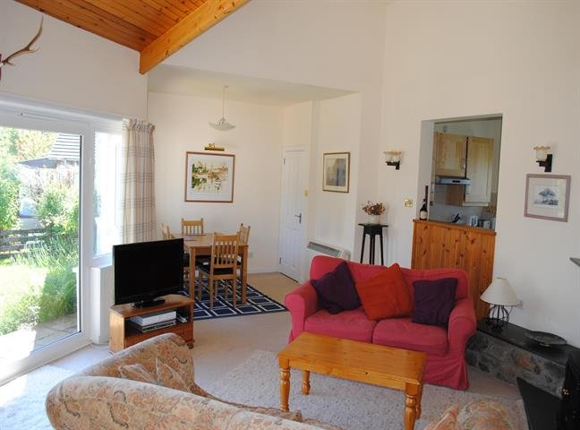 Bright spacious living room with views of the hills and the Sound of Mull.