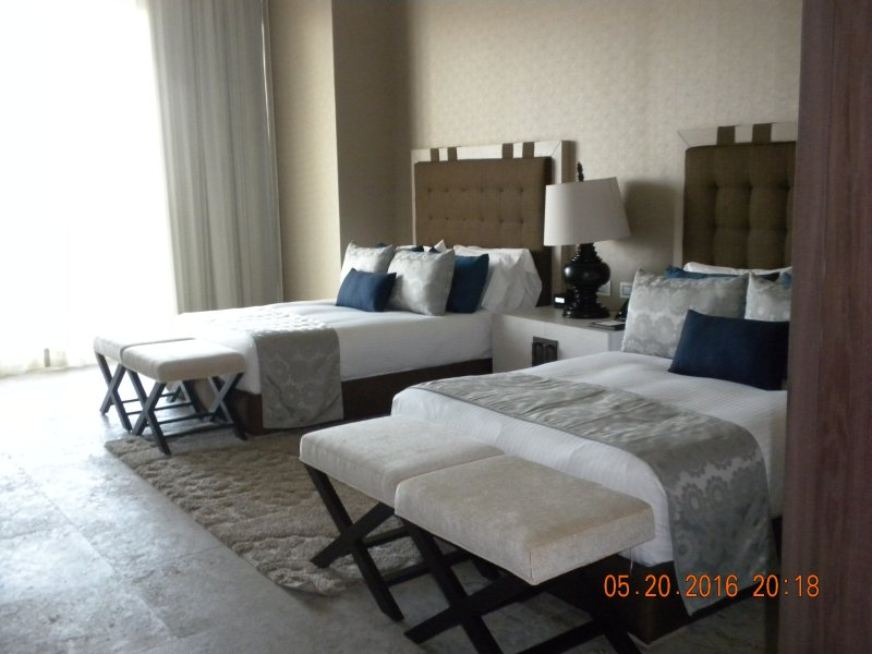 One of 2 bedrooms with 2 queen size beds