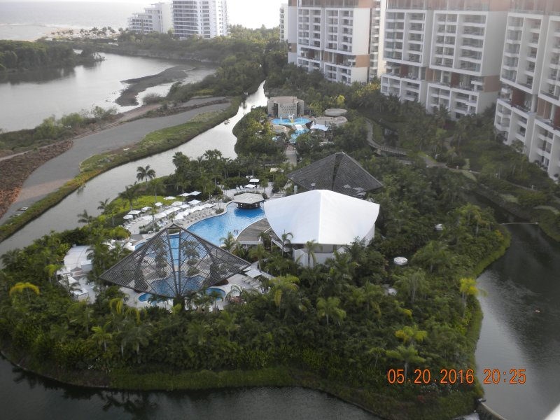 View of the one resort pool next to the river and out to the ocean