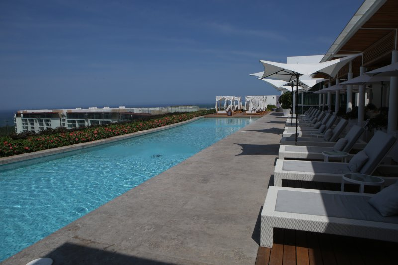 Roof-top pool with full service restaurant and bar