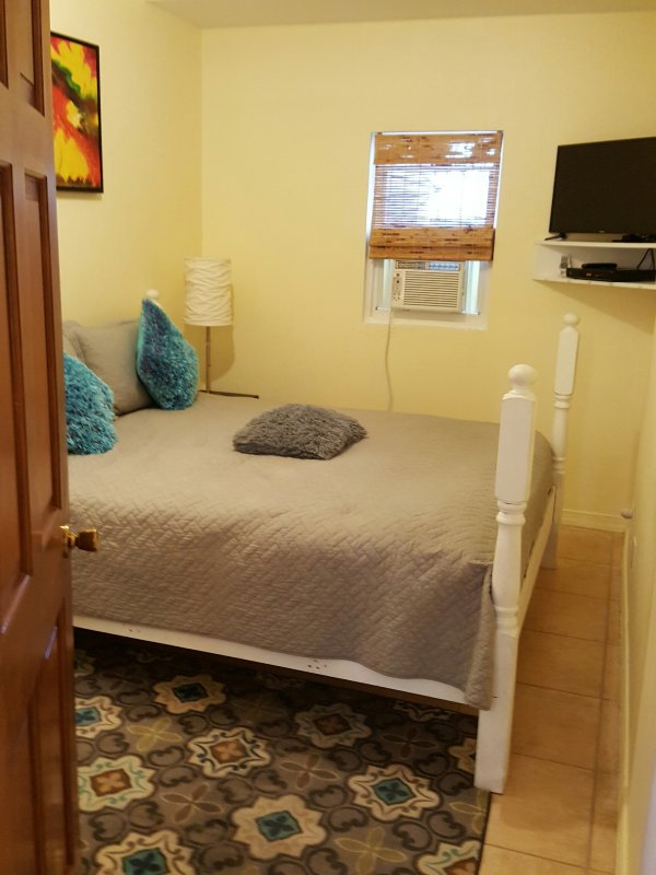 Second Bedroom with TV, air-conditioner & King bed
