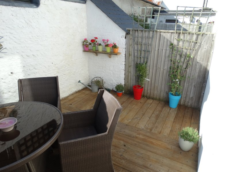 Walled and decked back courtyard garden