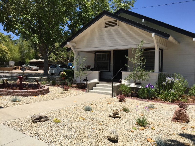 Classic Craftsman with inviting front porch perfect for a morning cup of coffee or afternoon wine